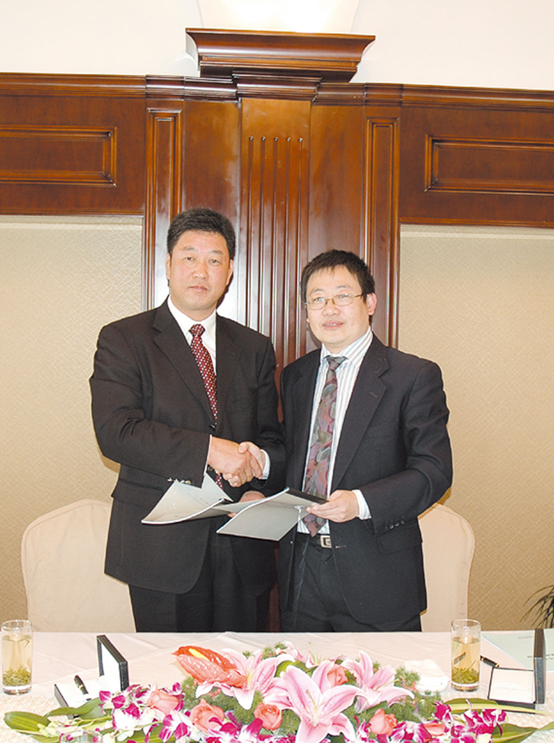 """On November 21, 2007, the Agreement on Equity Capital Increase was formally signed between Forchn Holding Group and Zhang Xiaoquan, which indicated the success of the second restructuring of """"Zhang Xiaoquan""""."""